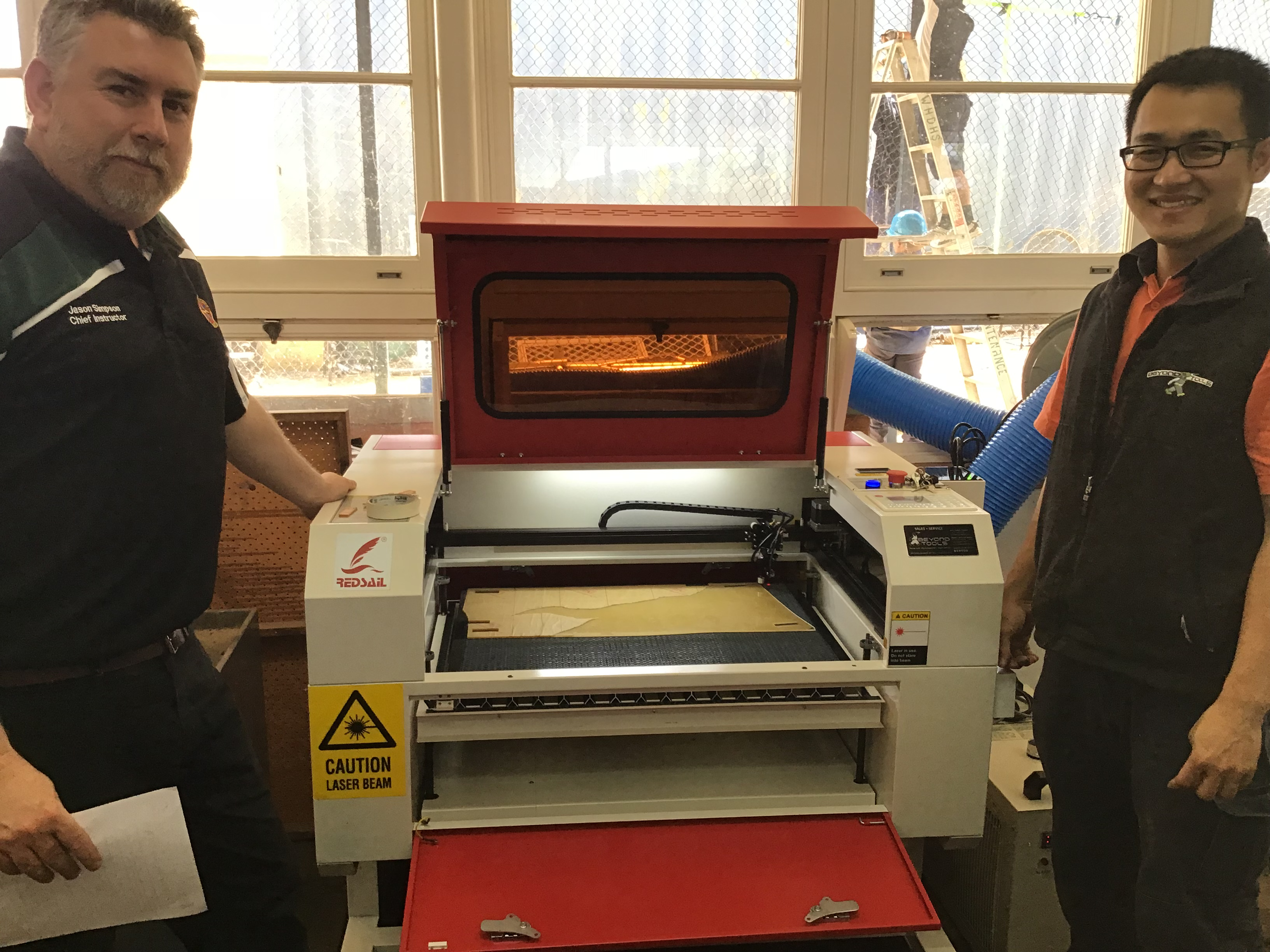 /uploaded_files/media/gallery/1595486379Jason by the laser cutter 18.JPG